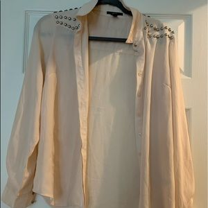 Cream blouse with silver accents on sleeve
